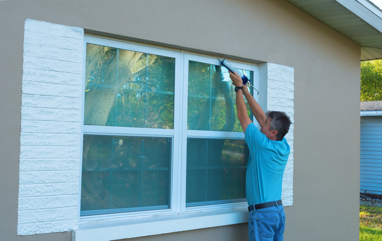 homeowner caulking window