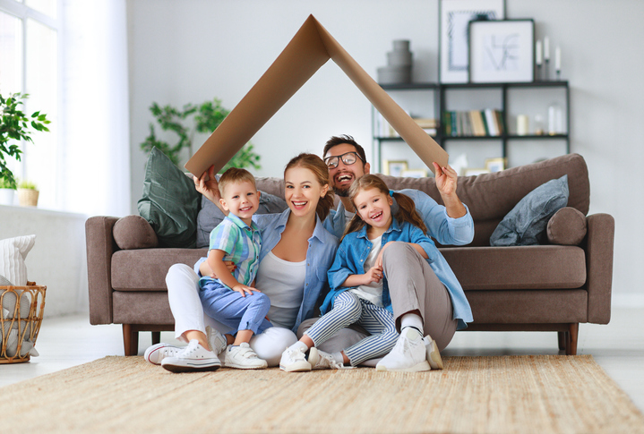 family at home in front of couch
