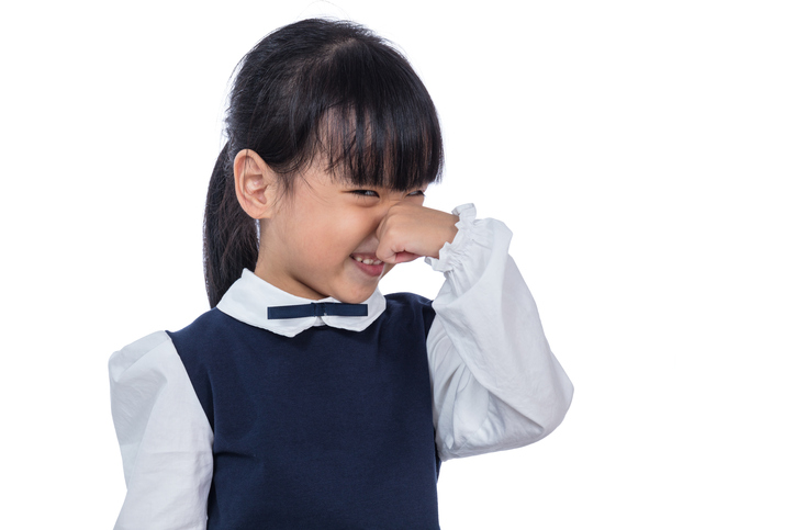 child holding nose because of smell
