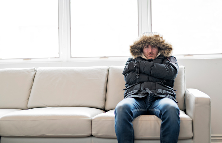 cold man on couch