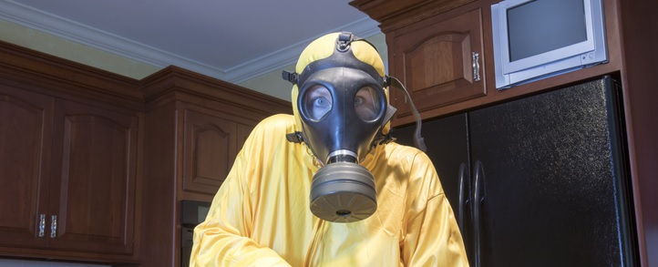 woman in gas mask in the kitchen
